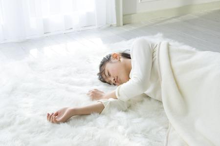 sheep skin: Girl sleeping on sheep skin