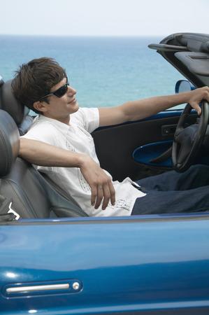 sportcar: Man driving a sportcar