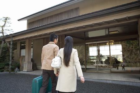 spa resort: Couple walking in to spa resort