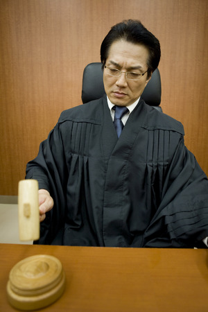 oc: Judge holding gavel and adjudicating