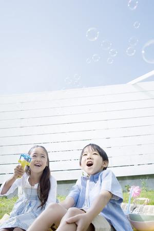 blowing bubbles: Children blowing bubbles