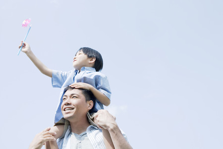 Asian father and son outdoors
