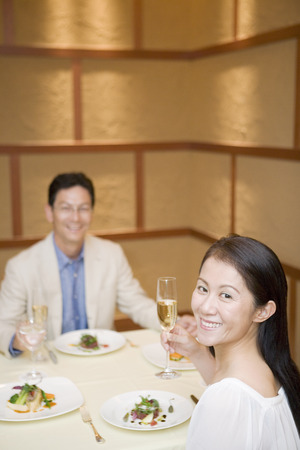 couple dining: Asian couple dining at a restaurant