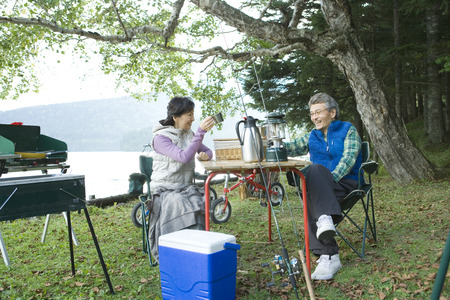 barbecuing: Asian couple out barbecuing