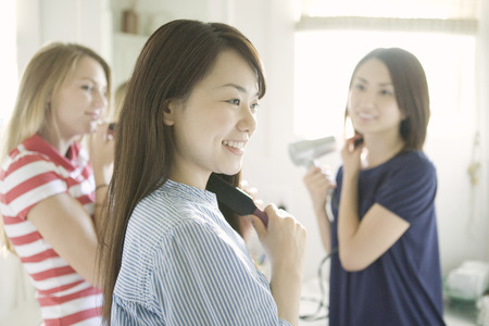 blow dry: Women grooming themselves