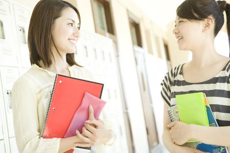 corridors: Female students at corridors Stock Photo