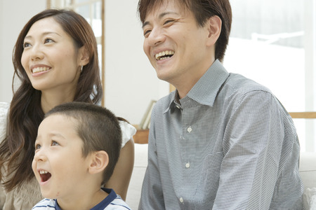indoors: Happy Asian family indoors