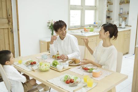Asian family eating breakfast