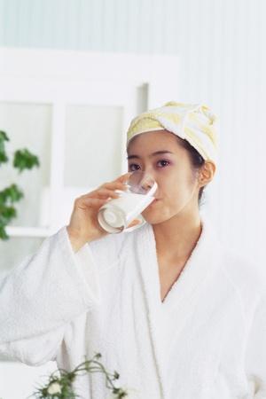 oriental bathrobe: Woman drinking milk