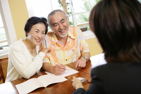 salesgirl: Elderly Couple Speaking to Salesgirl Stock Photo