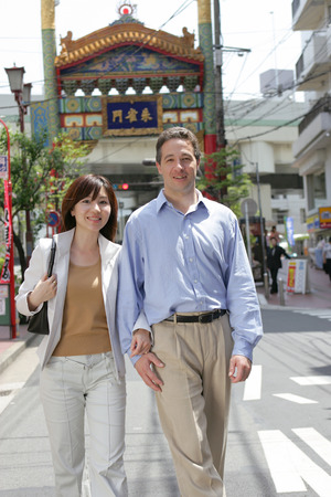 fold ones arms: Couple walking