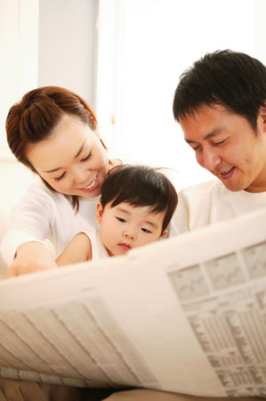 Parent and Child reading a newspaper photo