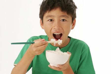 upper school: Boy Eating Rice Stock Photo