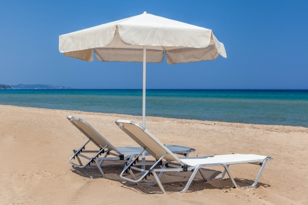 sun beds and sun umbrella on the beach photo