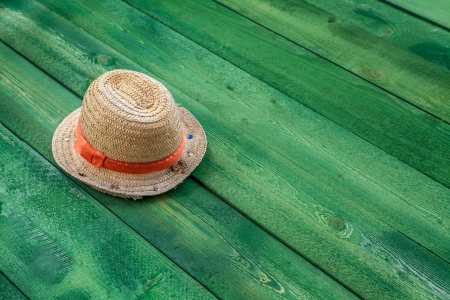 Summer panama straw hat isolated on green wood table