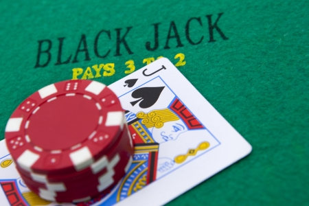 black jack with red poker chips in the background.