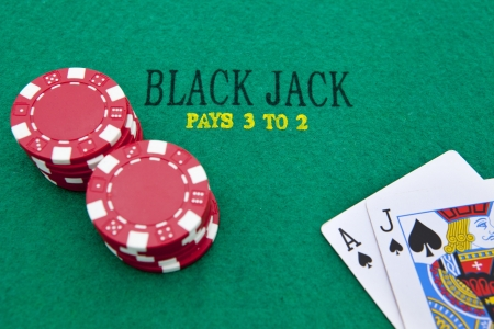 Ace of spades and black jack with red poker chips in the background. Reklamní fotografie