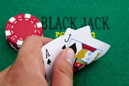 Ace of spades and black jack with red poker chips in the background. Stock Photo