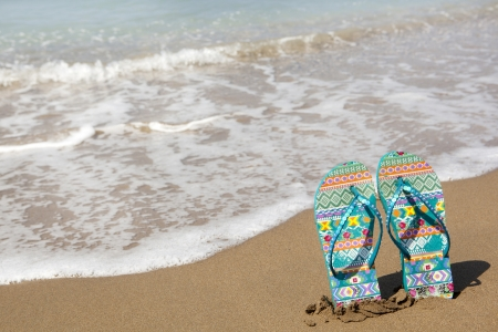 flops: Blue beach slippers on sandy beach, summer, bathing Stock Photo