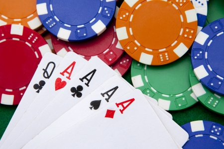 poker, four aces over a background with casino chips photo