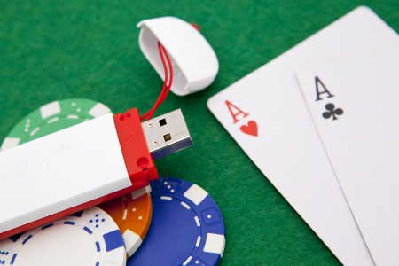 Texas holdem pocket aces on casino table with internet stick connection photo