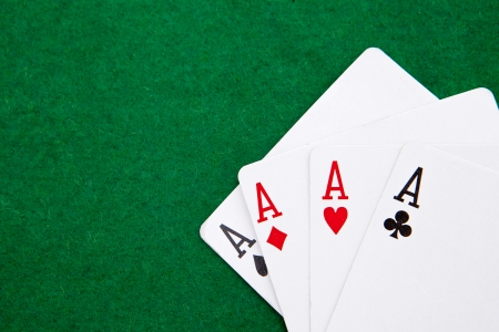 quads on a green casino table with space for text photo
