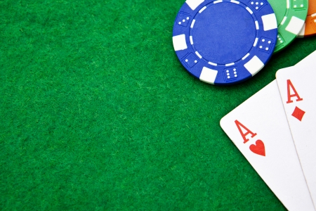 hold'em: Texas holdem pocket aces on casino table with copy space and chips