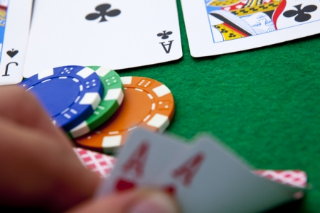 Texas holdem pocket aces on casino table Stock Photo
