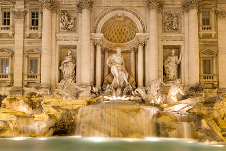 caput: Trevi Fountain by night in Rome, Italy