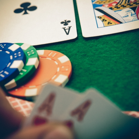 Texas holdem pocket aces on casino table photo