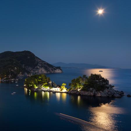 Beautiful Greek village Parga by night, photo taken in Greece, Epirus region Redakční