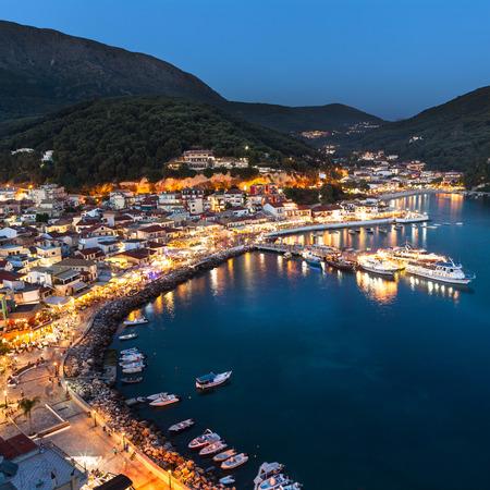 Lights of Parga Greek village by night, Greece, Ionian Islands