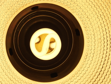 volts: energy saving 220 volts spiral lamp Stock Photo
