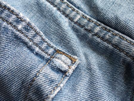 ragged: worn out blue jean