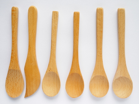 set of four beech wood tea spoon on white background