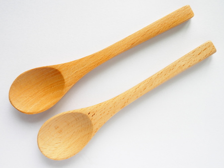 double beech wood tea spoon on white background Stock Photo