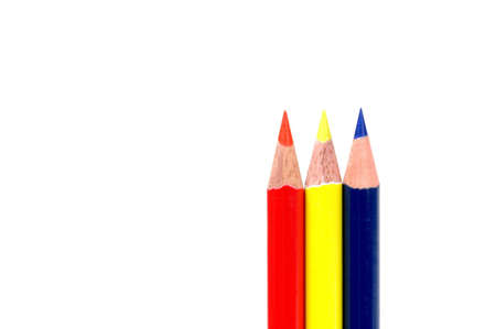 colored pencils showing primary colors isolated on white background