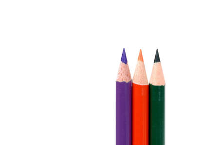 Colored pencils showing secondary colors isolated on white