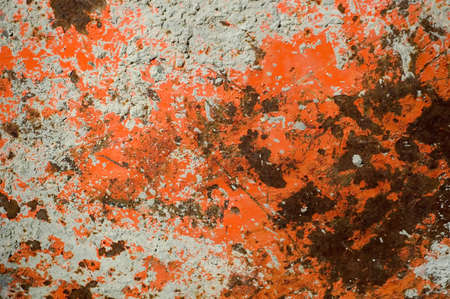Orange White Gray and Rust Colored Background on Side of Old Wheel Barrow