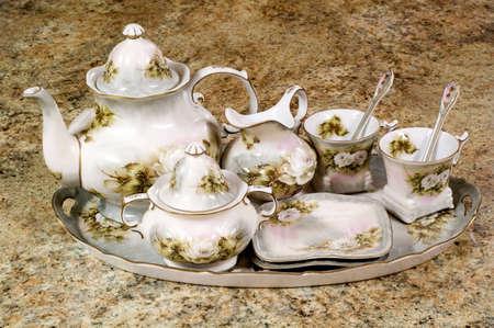 Floral tea set sitting on counter Stock Photo