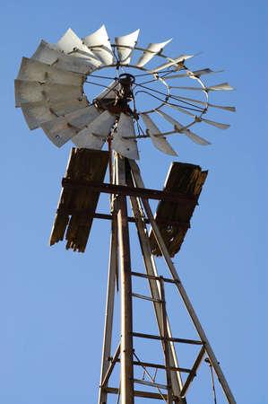 Old Windmill Against Blue Sky Standard-Bild