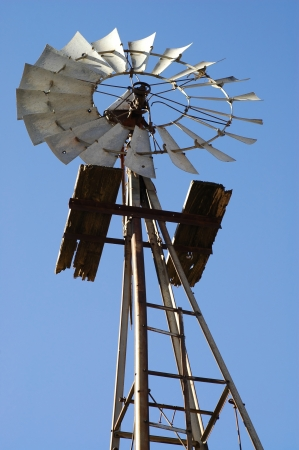 Old Windmill Against Blue Sky Stock Photo
