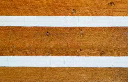 Siding on Log Cabin Sealed by Chinking