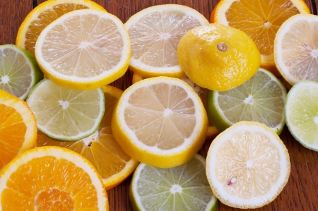 Lemon, Lime and Orange Slices on a Table