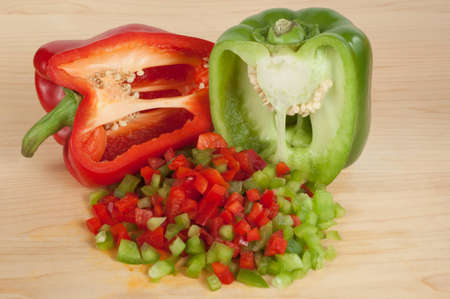 Red and Green Sliced and Chopped or Diced Bell Peppers Stock Photo