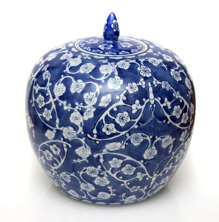 vase: A Chinese blue ceramic ginger jar in isolation Stock Photo