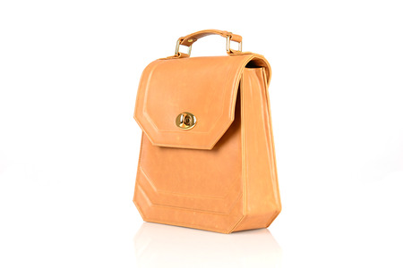 personal shopper: orange woman bag isolated on the white background Stock Photo