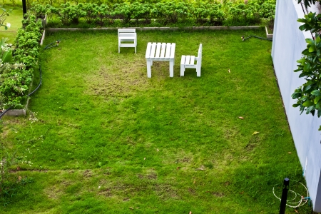 cute white furniture set in the yard  photo