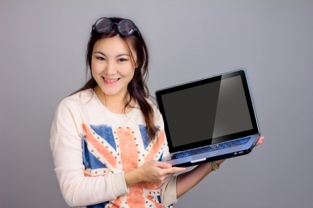 advertisment: asian girl present nice advertisment  Stock Photo