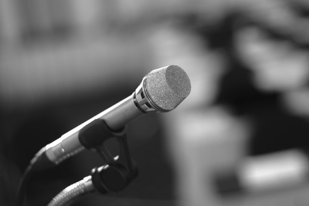 gig: microphone in conference room on a dark background Stock Photo